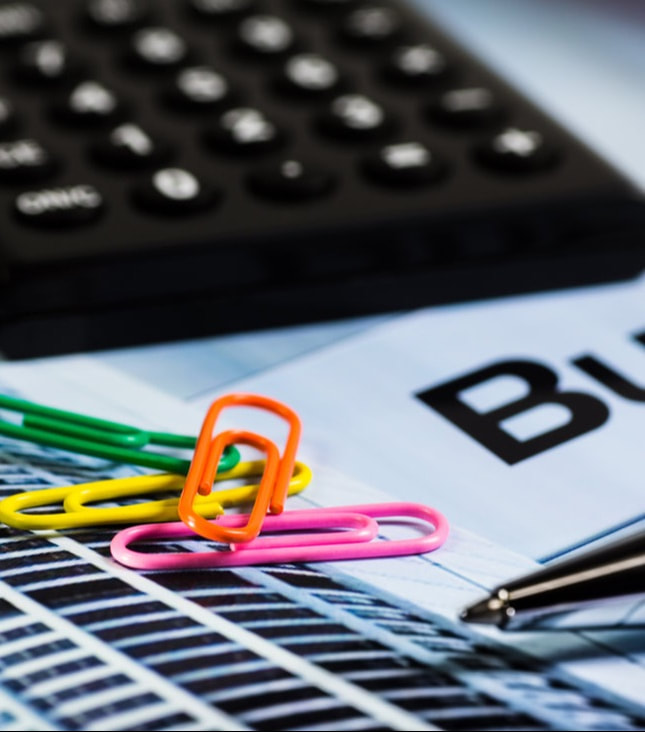 Colourful Image of Bookkeeping tools, a calculator and paperclips